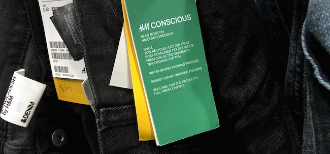 A H&M Conscious tag is seen on a pair of pants at their retail store in New York December 7, 2015. To match CLIMATECHANGE-SUMMIT/CONSUMERS REUTERS/Shannon Stapleton - RTX1XLUJ